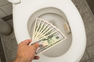 Flushing-Money-Down-the-Toilet