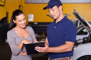 woman and car technician